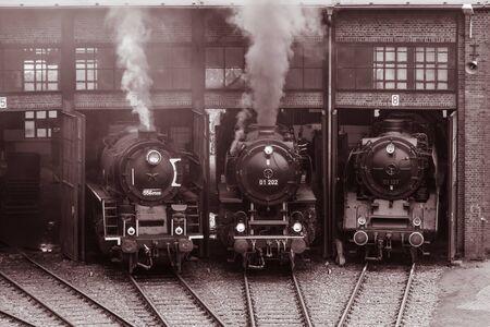 Old vintage steam locomotive in a depot