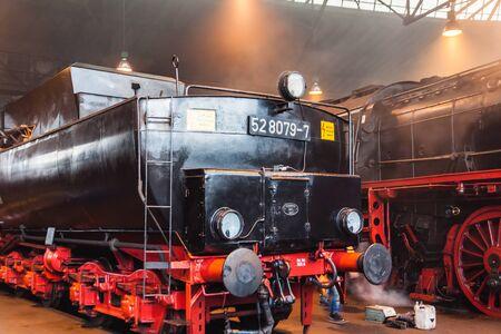 Old vintage steam locomotive in a round house