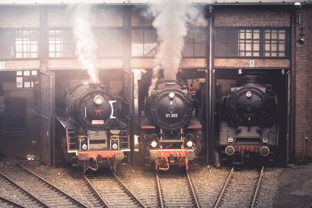 Old vintage steam locomotive in adepot