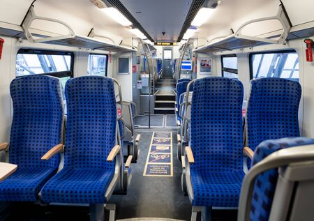 Blue seats inside train cabin