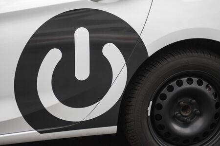 Electric switch sign on a car