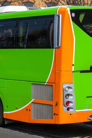 A green flix bus seen from the rear