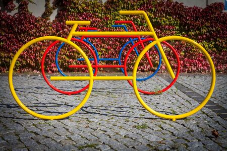 Colorful bicycle statues as stand