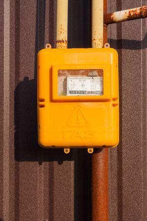A yellow gas meters in the street in Ukraine Imagens
