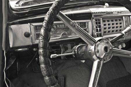 A vintage car cockpit with steering wheel Banque d'images