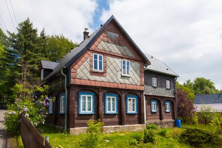 An old wooden house in good condition in Bohemia, Czech Republic