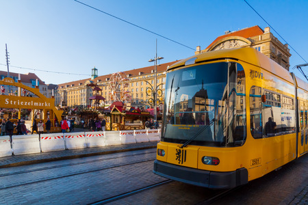 A tram in front of the christmas market in Dresden, Saxony