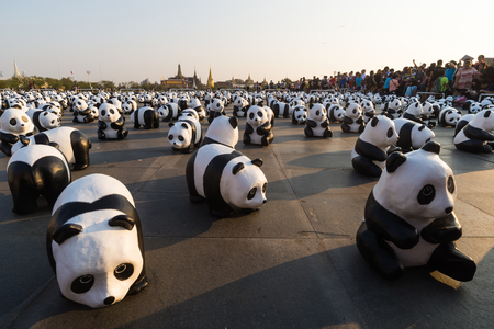 mob: SANAM LUANG BANGKOK THAILAND- MAR 4:A cute flash mob of 1,600 papier-mch pandas has occupied Sanam Luang this afternoon, brightening up the historic ground beside Wat Phra Kaew. Editorial