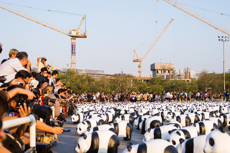 occupy: SANAM LUANG BANGKOK THAILAND- MAR 4:A cute flash mob of 1,600 papier-mch pandas has occupied Sanam Luang this afternoon, brightening up the historic ground beside Wat Phra Kaew. Editorial