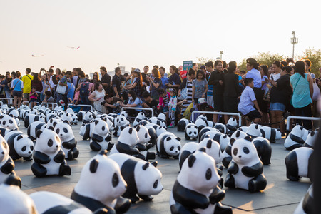 cuddly baby: SANAM LUANG BANGKOK THAILAND- MAR 4:A cute flash mob of 1,600 papier-mch pandas has occupied Sanam Luang this afternoon, brightening up the historic ground beside Wat Phra Kaew. Editorial