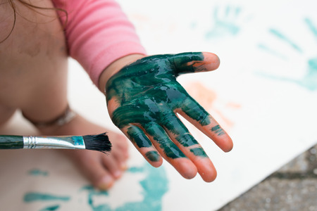 Child play with paint