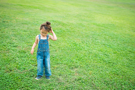 overall: Girl playing wearing overall Stock Photo