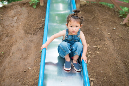 Girl playing in the slide