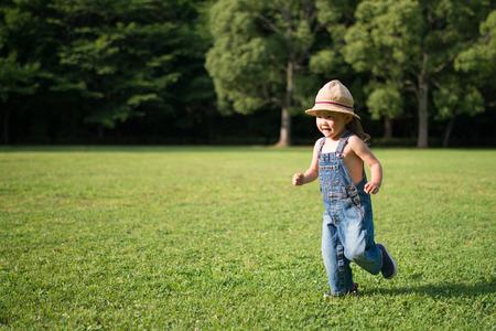 overall: Child running wearing overall