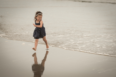 bare feet girl: Girl playing on the beach