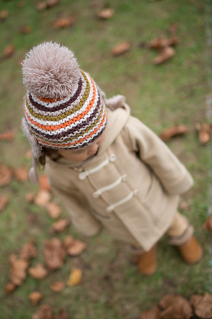 systemic: Little girl wearing a knitted hat