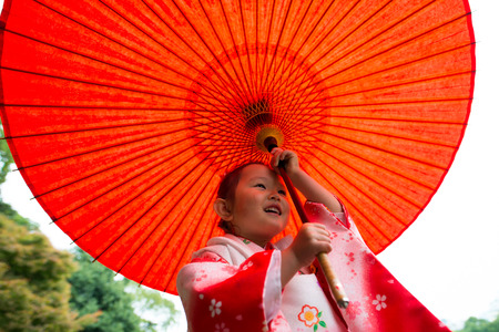 shichigosan holding Japanese traditional umbrella