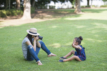 Mother taking a picture for her daughter