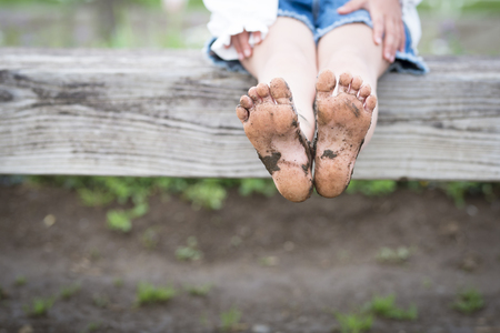 Muddy child's feet