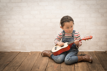 Little girl plays guitar
