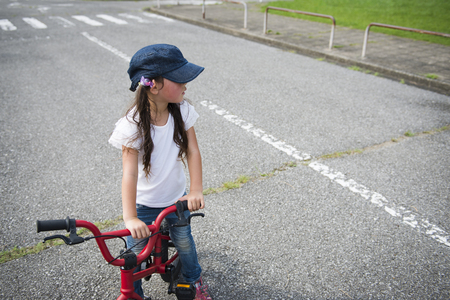 Little girl riding on the bicycle Stock Photo