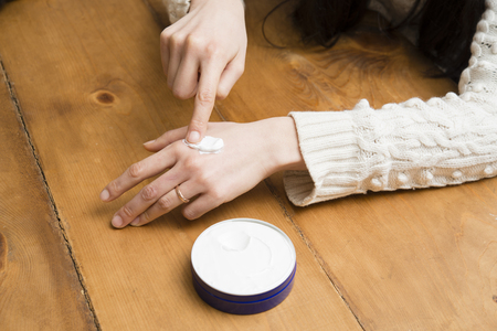 Close up of beautiful hands and hand cream