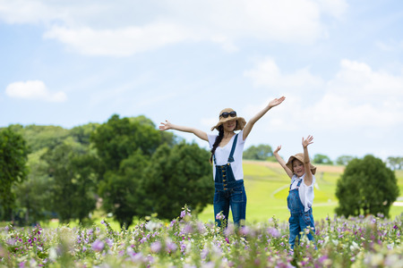 Happy mother and daughter in the flower field