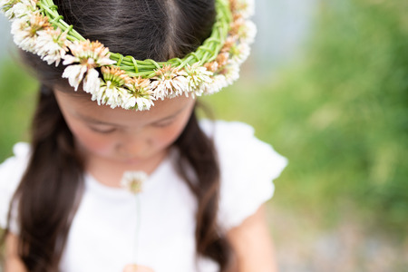 Girl wearing a crown of flowers