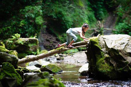 Child crossing logs