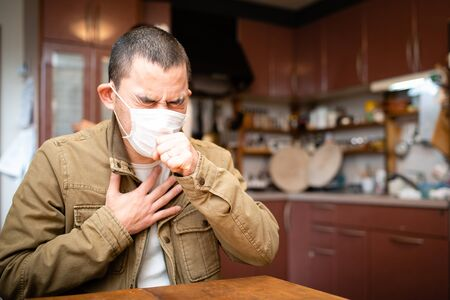 Men to cough wearing a mask