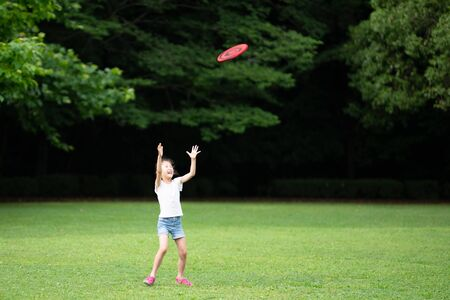 Girl playing with flying disc