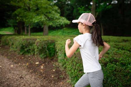 Girl doing cross country running 免版税图像