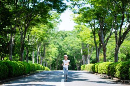Girl running in nature park