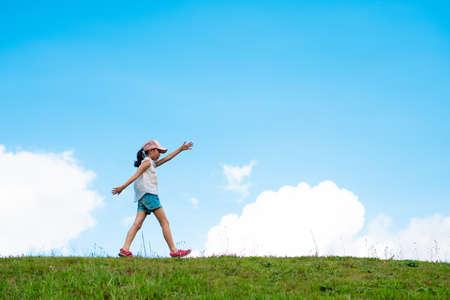 Child walking in the meadow