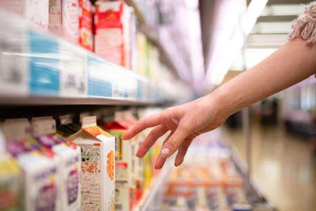 Women's hands shopping in a supermarket