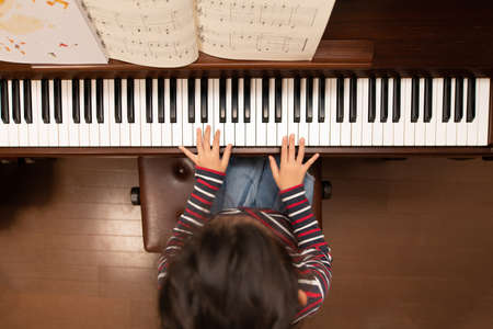 Girl  plays the piano