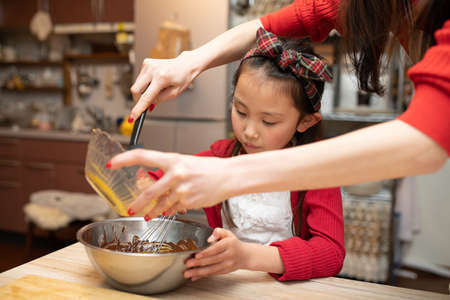 Mother and daughter making sweets