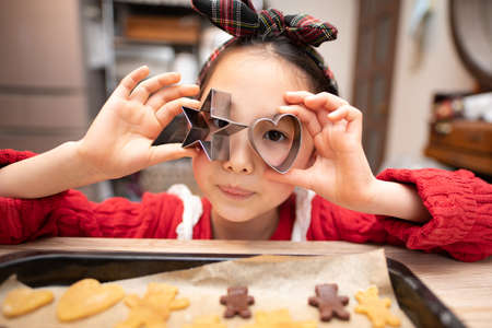 Girl making cookies at home