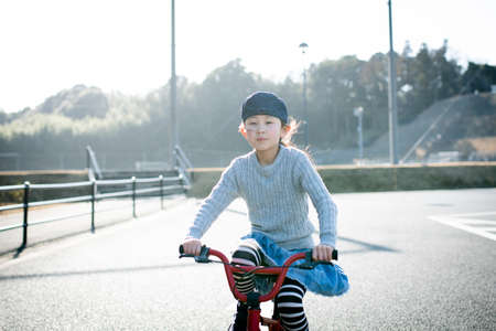 Girl playing on a bicycle