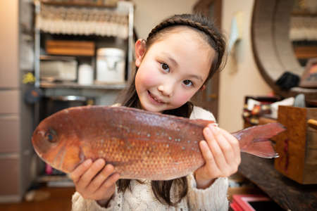 Girl smile with a fish Stok Fotoğraf