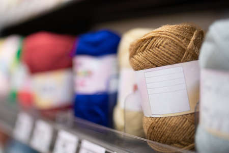 Yarn lined up on the shelves
