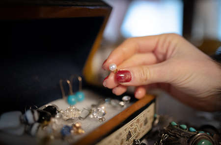 Beautiful women's hands choosing accessories