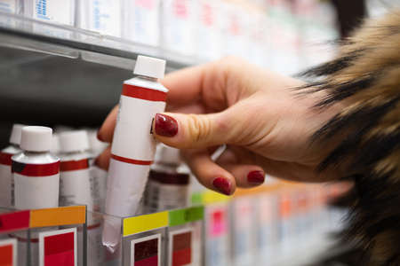 Beautiful woman's hand choosing paint