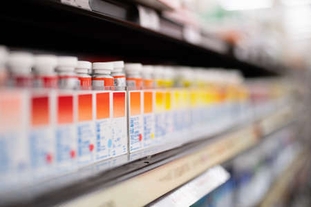 Paints lined up on the shelves