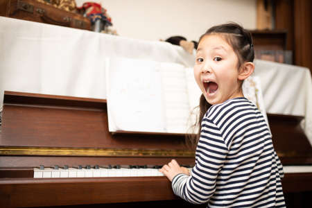 Girl surprised while playing the piano