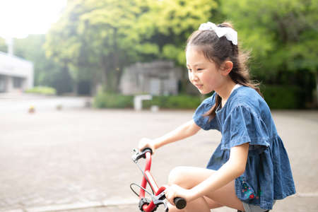 Girl riding a bicycle in the park