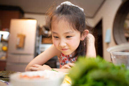 Girl looking forward to a meal Stock Photo