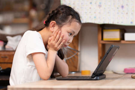 Girl using a laptop computer at home
