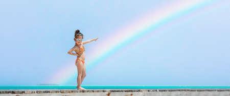 Little girl posing on a rainbow beach