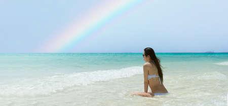 A woman relaxing on a rainbow beach